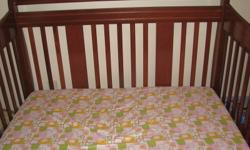 Storkcraft Deborah Convertible crib - changes to a toddler bed, and can be used as head & footboard for a double bed. Cognac in colour. The crib is very sturdy and in great shape. Comes with a reversible mattress (infant/toddler sides). Matching change