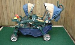 Double stoller with canopy top with safey straps model jeep easy to fold up asking $30 for it grey baby stroller with canopy top easy to fold up for travel asking $15 for it