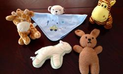 Five stuffed toys for babies.