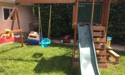 2 years old, can accommodate 3 swings and has a little table on size with bench Toddler swing not included, comes with 2 kids swings and a Ring swing (swings has never been used) We will help dismantle and load no deliveries available