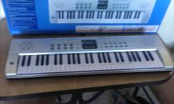 Near new played twice table organ runs on batteries. Was 59.99 sell $25.00 no holds. Has 54 functions, great for child's first keyboard or adult.