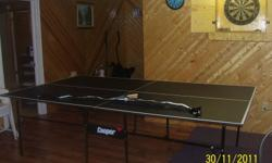 Regulation size ping pong (tennis) table includes 2 bats and net. Never used.