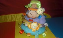 TAGGIES plush ring stacker.In excellent like new condition, comes from a clean non-smoking home and used briefly for one child. Each ring makes it's own playful sound. The topper rattles, bumble bee crinkles, bear rattles, hippo squeaks, lion giggles,
