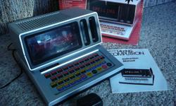 Sears Talking Computron is an educational toy for ages 5 and up. It talks, asks questions, and displays words on a screen. - Has 19 activities to build skills in spelling, math, reading & music - Includes manual, original box and AC adapter - Automatic
