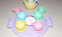 We have a cute Fisher-Price tea pot set and a little electronic keyboard. The keyboard needs 4 AA batteries. Plays music, freestyle, or the keys light up to guide the next note in a series of pre-programmed songs.   We're asking $10 for both, obo.   I