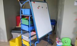 Storage unit with multiple drawers. On wheels for easy moving. Magnetic flip write & wipe board.