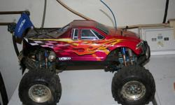 i have my 4x4 monster truck for sale it is running an oversized os 3.0 and has reverse. this truck comes with a second chassis, motor etc. all dissasembled. there is a large box full of extra and spare parts, tires a-arms etc as well as a second remote