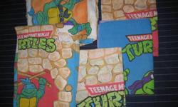 """Two Teenage Mutant Ninja Turtles sheets - 1 flat top sheet and 1 fitted bottom sheet for twin bed with 3 pillowcases included. Sheets measure 66"""" x 85"""" and are tagged as """"twin"""" size. These sheets have the copyright """"Mirage Studios 1988"""". These sheets"""