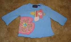 The Children's Place blue LS shirt with floral applique design and lettuce edge sleeves.  I've paired this up with a retro looking pair of jeans with wide legs and pleated inserts.  Together they have a bit of a bohemian look!  Both items in VGUC, no rips
