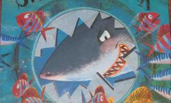 Suspenseful and exciting story about the fish in the ocean banding together against the shark in the dark... Story is easy to read with rhyming rhythmic prose. Illustrations are great and it's not too wordy or long - perfect bedtime book. Good used