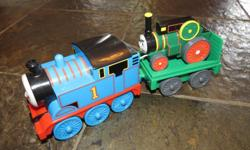 Includes Thomas and trailer with smaller engine. Pull back small engine to ride up ramp and Thomas pulling trailer will speed off.