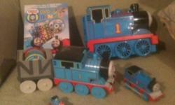 THOMAS THE TANK ENGINE COLLECTIBLES. 1.Musical thomas w/spining records & drives 2.DVD Bingo w/ thomas 3.Mini thomas metal train w/santa hat on 4.Medium size thomas spin master Carrying case gone from picture (Make me an offer)!!!