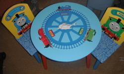 Thomas the Tank table and two chairs.  In good condition - a few small scratches and pens marks here and there.  Great to use as a snack table or for homework.  Sell's for $100 at Toys R Us.  Must pick up from Canmore.