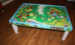 Thomas the tank engine table, Huge selection of tracks, trains and buildings. Roundhouse, water tower, mountain, bridges, tunnels. Great condition, close to $1000 worth of wooden thomas railway toys.