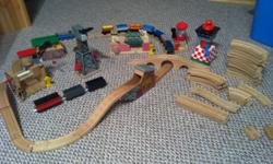 A wide variety of tracks, trains and new and old extra parts for a cool train set! Well loved but still in good condition. Tracks had been glued down at one time so bottom of tracks have dried glue but it doesn't affect how they connect. $125 for