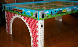 Original owner of this Thomas & Friends Wooden Railway set; complete with deluxe Thomas train table ($350) and Thomas storage box ($150). This set is sold as one complete set as shown in the photos. Set includes multiple wooden train tracks (various