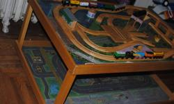 Thomas the train table. Solid wood. Comes with some trains. Please e-mail or call after 5pm. 895-0227