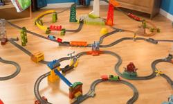 Plastic train tracks include some extras such as a tunnel, towers, and trains. 75 pieces!