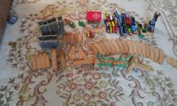 Just over 100 pieces in this train set, including: 2 electric Percy Trains 1 electric Edward Train 1 Rocky, 1 Hank A bunch of magnetic connector trains Water Tower Suspension Bridge Magnetic Cargo Crane Hospital Circular Ramp - can build a circular ramp