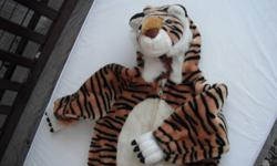 "Fun fur, tiger halloween costume. Worn once. Super cute.Tag says size ""small"", fits approx. size 3T. The hands and feet are open, and can allow for size differences."