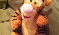 """Roughly 8"""", moveable arms, legs and squeeze my tummy and I sing """" the wonderful thing about tiggers"""" song. I use 3AA batteries and have a on/off switch. In good condition."""