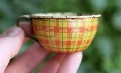 I am looking for 4 tin teacups to go with a vintage tea set - preferably in a solid color - any condition will do.