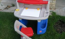 This sturdy table and creative play activities for children are very suitable. It has a large work surface molded compartments, plus a dry-erase wipe clean surface, writing easy, open to a storage area below. A raised shelf holds art supplies and has a