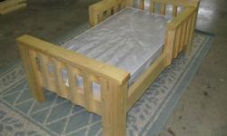Rustic looking toddler bed (new) with clear coat finish.  If you need a matress I have one for an extra $10 (used).  Nice Christmas gift!  Would look real good in that cabin of yours by the lake.  It's built for those exceptionally rough and tough cute
