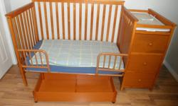 This is a convertible crib that I am selling as the toddler bed only.  Change table is attached and can be detached to be used as a small dresser. Small stain on one of the drawer fronts.  Roll-away trundle for under bed storage.  Mattress included is