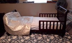 Hard wood toddler bed c/w mattress and mattress cover. All in excellent condition. No stains or tears. Pick up only please