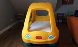 Toddler car bed with brand new crib sized mattress. In excellent condition