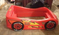 I have a cars race car toddler bed, comes with cars bedding, cars toy shelf, cars table and chairs set and set of cars curtains. Has mattress but needs new one. Everything is in good condition. Message or call if interested. This ad was posted with the