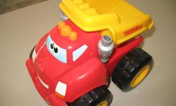Tonka dump truck made with soft rubbery material Runs on batteries and has sounds
