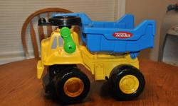 "I have available a Tonka dump truck with ""rumble"" tires, green lever dumps bucket on the back-$10 Chuck the talking dump truck-talks, moves his bucket when he talks and drives forward.  Very cute toy-$10"