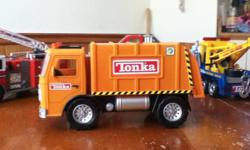 Great selection of tonka trucks, including couple not so easy to find now. Garbage truck with sound, Power Supply truck with sound, really cool, folds down with crane for moving generators (?) around, Fire ladder truck with sound , Tow truck with sound,