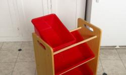 Toss your toys, craft supplies, tools, sewing stuff, or other knick knacks into this cute little shelf that holds 3 red plastic bins!