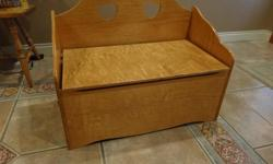 """Oak finish wood toy box . Lid designed not to pinch little fingers. 29"""" wide, 151/2"""" Deep, 23"""" high back, seat height 12""""."""