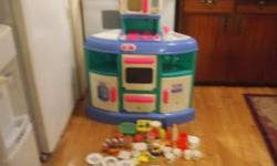 Excellent condition ....lots of utensils ,dishes etc included fridge stove oven top microwave etc / includes play food! Pricing is firm at $40 *see my other ad's also*