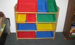 Excellent used condition! Excellent for organizing and storing toys. Comes with multi-coloured bins. Worked great for storing kids kitchen toys, play food, blocks, baby toys, little people and miscellaneous items as well.