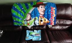 Toy story themed toddler bed with mattress and bed sheet set. mattress has a small cut on the bottom, used three times, to purchase new $250.00, still in very good condition. call, text 1 250 902 1100, or email Steve