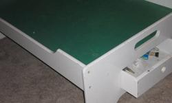 "Great table for kids toys - used for train sets and play mobile. One drawer on each end and hole cut out on top for cords. 48x33x18"" ; In good shape."