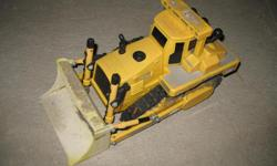 Plastic toy tractor. Used to run on batteries but not tested lately. Used lots in the sand but kids older now & have moved on to other things.