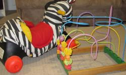 zebra ride on toy (have the rocker part too i believe). good used condition $5 other toy $10 Tad- SOLD Learning Puppy (small tear on cheek) $5 Lily EUC - $8 Tag Jr with two books - $25 Little People play pad - makes sounds, great for learning. comes with