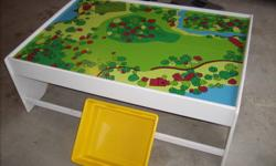 TRAIN TABLE WITH FOUR BINS IN EXCELLENT CONDITION.