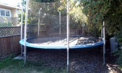 14' Diameter round trampoline with pads and safety net.