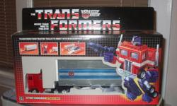 This is a reissue of the original 1984 Optimus Prime model, which is in mint condition....taken out of box once to apply stickers. Stored in glass case in box which is in mint condition as well. Serious inquiries only please, as this is a MUST HAVE for