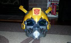 Bumblebee helmet with sounds and voices. In excellent condition as it wasn't really played with much.