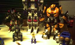 """1 12""""vintage transformer the others newer and jet turs into gun $25.00 for the lot as is no holds"""
