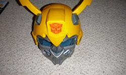 Comes from a smoke free home. Gently used, excellent condition, bought for my son but never really played with it. Need it gone by Christmas to make room for new toys. $15 obo. Suit up just like the BUMBLEBEE character and prepare to save the universe