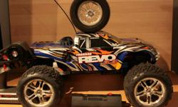 Used Traxxas Revo Comes with Remote EZ Start / Charger Extra Set of Tires Price was $450 Now $300. Need the cash to fix my car.     TRAXXAS REVO 3.3 (#5308) 17mm aluminum splined wheel hubs and nuts Forward only transmission Large capacity 150cc fuel